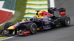 German driver Sebastian Vettel of Red Bull in action during of the Brazilian Formula one Grand Prix at the Interlagos racetrack in Sao Paulo, Brazil, on November 24, 2013.                            AFP PHOTO/MIGUEL SCHINCARIOL        (Photo credit should read Miguel Schincariol/AFP/Getty Images)
