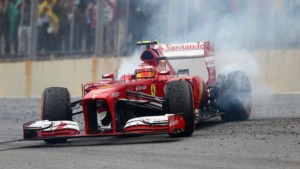 SAO PAULO, BRAZIL - NOVEMBER 24:  Felipe Massa of Brazil and Ferrari performs donuts as he finishes his last race for Ferrari following the Brazilian Formula One Grand Prix at Autodromo Jose Carlos Pace on November 24, 2013 in Sao Paulo, Brazil.  (Photo by Clive Mason/Getty Images)